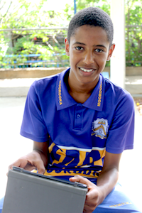 Male student using iPad
