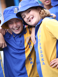 Friends at Moorooka State School laughing